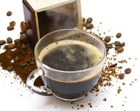 A cup from coffee. A cup from coffee against coffee grains Stock Photography