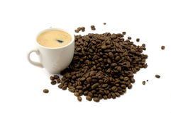 Cup of coffee. And coffee beans on white background Royalty Free Stock Photo