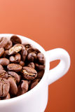 Cup of coffee,. Full of beans Royalty Free Stock Photos