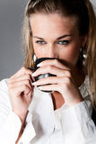 With cup of coffee. Young woman with cup of coffee Stock Photography