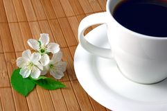 Cup of coffee. A white cup on the breakfast table Royalty Free Stock Image