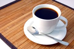Cup of coffee. A white cup on the breakfast table Stock Image