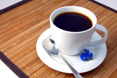 Cup of coffee. A white cup on the breakfast table Royalty Free Stock Photo
