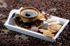 Cup of coffee aand macarons Stock Images