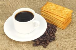 Cup of Coffee accompanied with Cream Crackers Stock Image