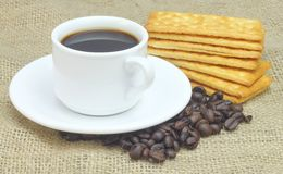 Cup of Coffee accompanied with Cream Crackers Stock Photos