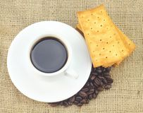 Cup of Coffee accompanied with Cream Crackers Stock Photography