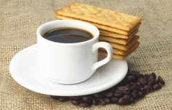 Cup of Coffee accompanied with Cream Crackers Royalty Free Stock Photography