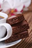 Cup of coffee and aerated chocolate. macro vertical Stock Photo