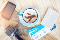 Cup of coffee with the airplane of cinnamon on foam royalty free stock image