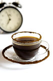 Cup of coffee and alarm Stock Image