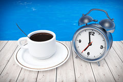 Cup of Coffee and Alarm Clock in front of Ocean. 3d Rendering Stock Image