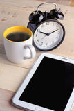 Cup of coffee with alarm clock and smart phone Stock Photo