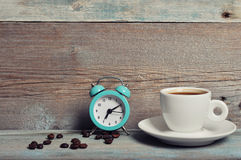 Cup of coffee with alarm clock Stock Photos