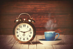 Cup of coffee and alarm clock Stock Photos