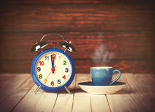 Cup of coffee and alarm clock Royalty Free Stock Photography