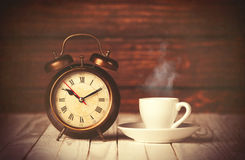 Cup of coffee and alarm clock Stock Photography