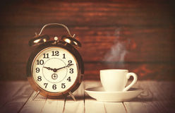 Cup of coffee and alarm clock Royalty Free Stock Image