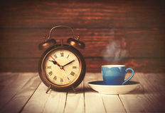 Cup of coffee and alarm clock Royalty Free Stock Photo