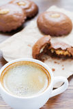 Cup of coffee and almond cookies Stock Photography