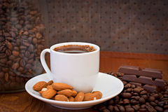 Cup of coffee, almonds and chocolate stock photo