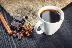 Cup of coffee with anise, chocolate and cinnamon Royalty Free Stock Photography