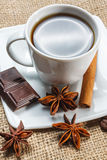 Cup of coffee with anise, chocolate and cinnamon Stock Images