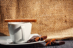 Cup of coffee with anise, chocolate and cinnamon Royalty Free Stock Image