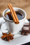 Cup of coffee with anise, chocolate and cinnamon Stock Photo