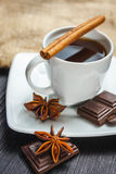 Cup of coffee with anise, chocolate and cinnamon Stock Image
