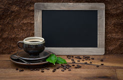 Cup of coffee and antique blackboard Stock Image