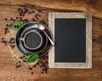 Cup of coffee and antique blackboard Royalty Free Stock Image