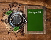 Cup of coffee and antique blackboard Royalty Free Stock Photography