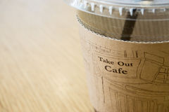Cup of coffee as a start up. A cup of coffee on wooden background Stock Image