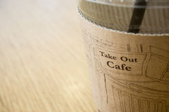 Cup of coffee as a start up. A cup of coffee on wooden background Royalty Free Stock Images