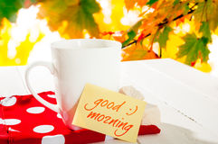 Cup coffee and autumn forest. Note with text good morning Royalty Free Stock Photo