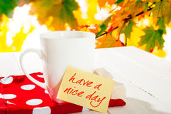 Cup coffee and autumn forest. Note with text have a nice day Royalty Free Stock Images
