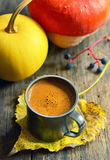 Cup of coffee on autumn leaf Stock Photography