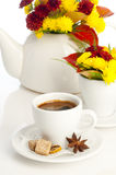 Cup of coffee on a background teapot with flowers Royalty Free Stock Image