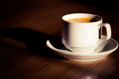 Cup of coffee. On a background a tree Royalty Free Stock Images
