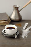 Cup of coffee on a background of the Turks and books on a wooden Royalty Free Stock Photo