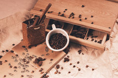 Cup of coffee and bag with cinnamon Stock Photography