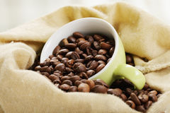 Cup with coffee in bag closeup Royalty Free Stock Photos