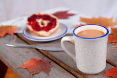 Cup of Coffee and bagel Stock Images
