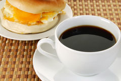 Cup of coffee and a bagel sandwich Royalty Free Stock Photos