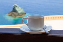 Cup of coffee on balcony with sea view Stock Photography