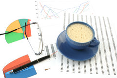 Cup of coffee, ballpoint pen and glasses Stock Photo