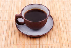 Cup of coffee on the bamboo Stock Image