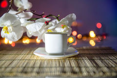 Cup of coffee on a bamboo napkin Royalty Free Stock Photo