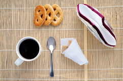 Cup of coffee on a bamboo napkin, top view Stock Image